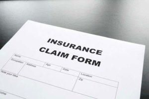 Insurance claim form with glasses.